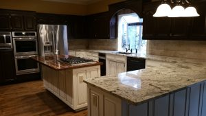 New granite counter tops, beautiful stained cabinets and backsplash for a modern feel